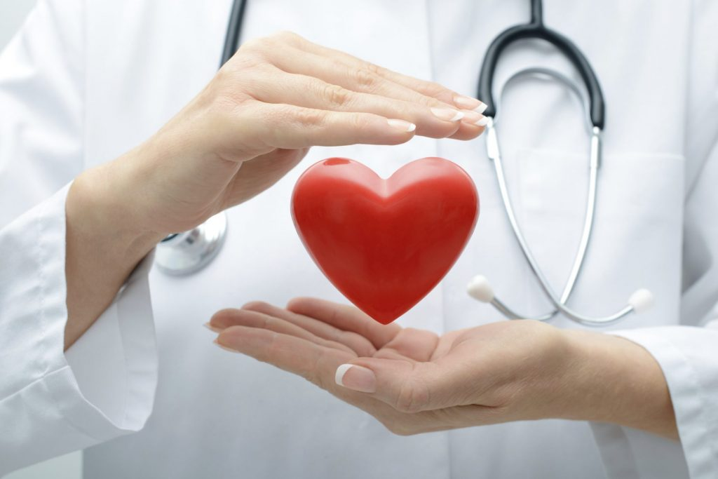 Doctor with Illustrated Heart in Hand